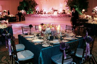 reception-tables-surround-dance-floor-and-wedding-band