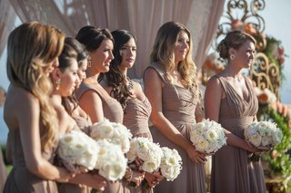 bridesmaids-holding-white-nosegays-in-brown-gowns