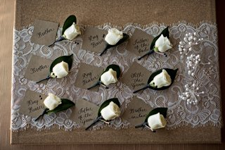white-rose-wedding-boutonnieres-with-name-card