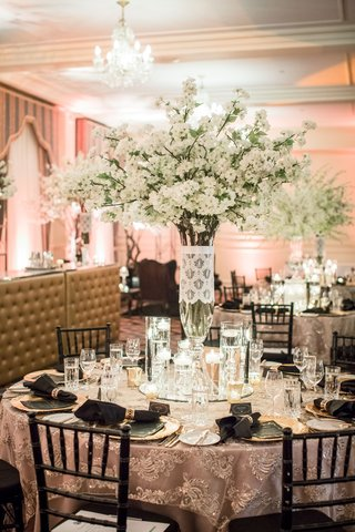 wedding-reception-round-table-texture-linen-black-chairs-candles-white-flowers-chandeliers-round