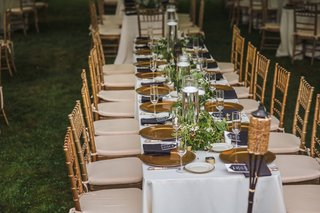 long-reception-table-white-linens-gold-chiavari-chairs-gold-chargers