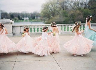 A Charming Fete Flower Girls pastel dresses and flower crowns