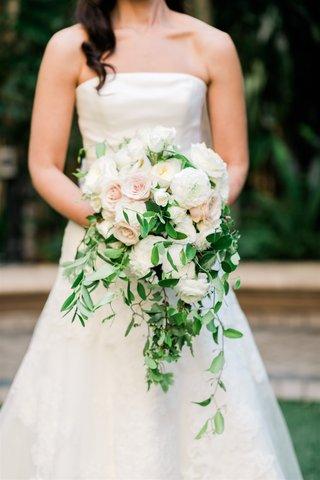bride in strapless vera wang wedding dress holding timeless bouquet greenery pink white rose garden