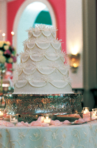 five-layer-cake-on-ornate-silver-stand