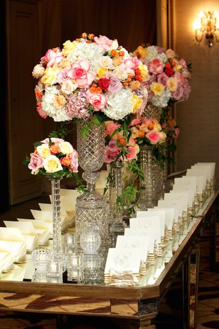 white-ceremony-booklets-on-mirrored-tabletop