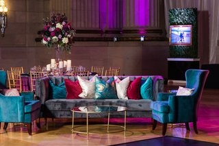 wedding reception with teal blue magenta red pillows and lounge furniture andrew w mellon wedding