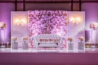 wedding reception violet purple lighting settee tufted on stage for newlyweds