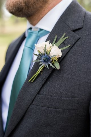boutonniere-with-eucalyptus-small-white-roses-and-scottish-thistle