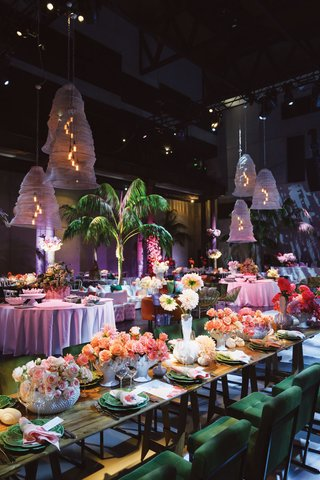 wedding reception unique lighting palm summer retro vibe pink flowers ombre velvet chairs