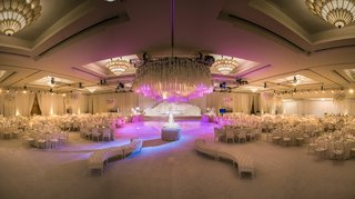white-hued-reception-space-purple-lighting-indian-hindu-wedding-california-furniture-ballroom