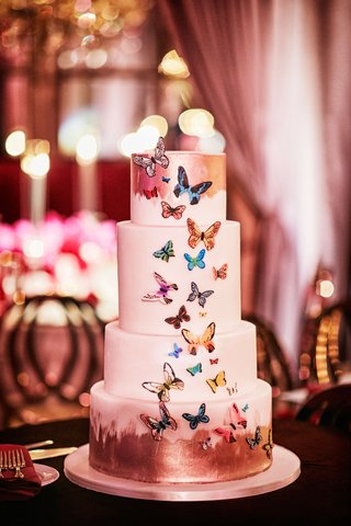 four-layer-wedding-cake-with-brushstroke-accents-and-colorful-butterfly-design-applique