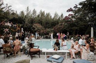ashley-castanos-daughters-of-simone-wedding-designer-guests-at-reception-pool-lake-como-italy