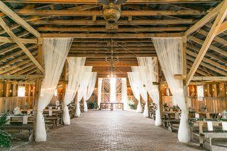 white-drapery-from-wood-rafters-beams-barn-rustic-wedding-ideas-locations-venues