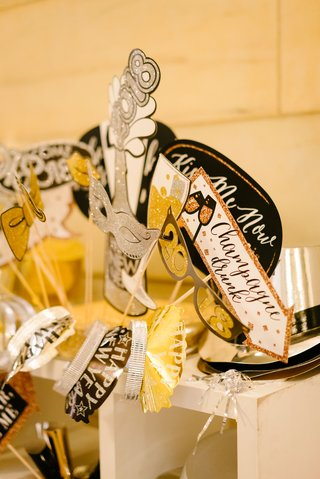 wedding-reception-new-years-eve-photo-booth-props-signs-tiaras-hats-champagne