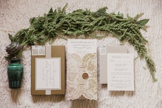 invitations-in-neutral-colors-pictured-with-greenery-and-succulents