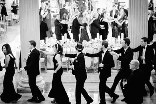 black-and-white-photo-of-guests-at-new-years-eve-wedding-reception-new-years-hats-and-tiaras