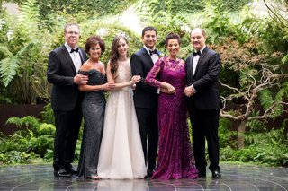 bride-with-mother-in-off-shoulder-grey-gown-and-groom-mother-in-long-sleeve-fuchsia-dress-tuxedos