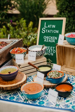 wedding-reception-food-station-latin-food-with-letter-board-menu-salsa-in-bowls-mexican-tile