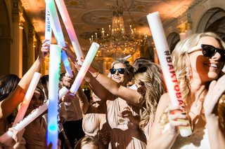 glow-stick-and-sunglasses-party-favors-on-dance-floor-with-wedding-hashtag