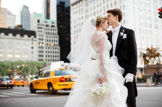 bride-in-new-york-city-with-yellow-cabs-in-lace-wedding-dress