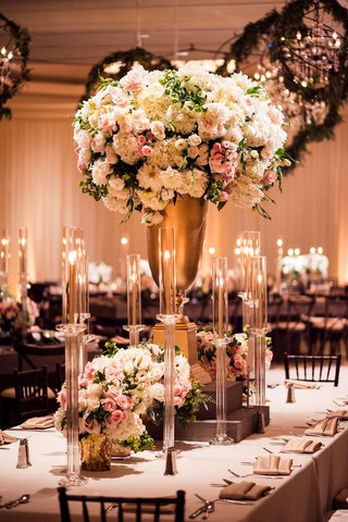 wedding-reception-flower-chandelier-greenery-tall-gold-centerpiece-white-pink-flowers-taper-candles
