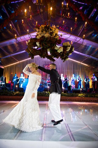 chandelier-over-lighted-acrylic-dance-floor-at-private-home-wedding-with-wedding-band-first-dance