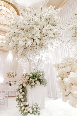 white-indoor-tree-with-globe-candles-and-full-white-cherry-blossoms