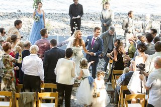 flower-girls-toss-petals-at-bride-in-pronovias-and-groom-during-recessional