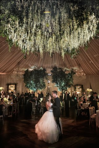wedding-reception-tented-ballroom-reception-bride-in-vera-wang-ball-gown-flower-chandelier-overhead