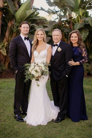 gerrit-cole-and-amy-crawford-with-brides-parents-mother-of-bride-and-father-of-bride-navy-dress