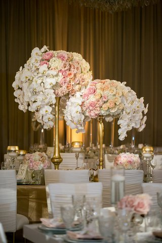 centerpieces-with-white-orchids-blush-cream-and-peach-roses-gold-stands