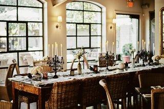 wedding-reception-halloween-wedding-ideas-black-candelabra-white-rose-spider-cobwebs-webs