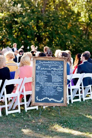 wedding-ceremony-program-on-a-chalkboard-with-ornate-wood-frame