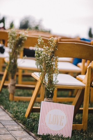 babys-breath-wrapped-in-burlap-on-ceremony-chair