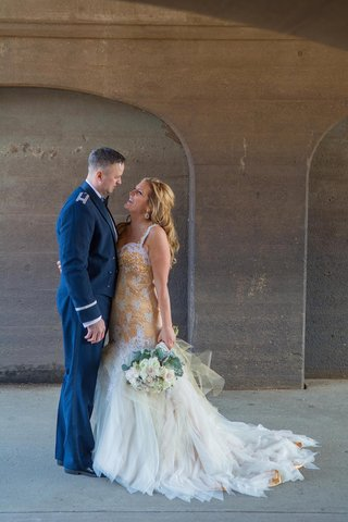 groom-in-mess-blue-uniform-and-bride-in-gold-dress