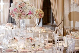 round-wedding-reception-table-with-crystal-vase-pink-rose-and-white-hydrangea-flowers-white-chairs