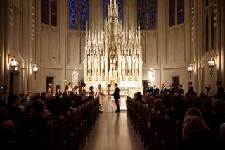 bride-in-monique-lhuillier-dress-and-groom-in-tux-at-st-james-chapel-in-chicago