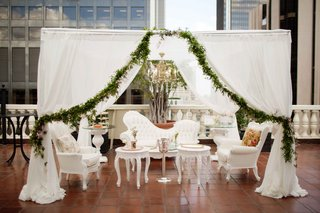 pre-ceremony-lounge-area-for-getting-ready-white-french-furniture-white-canopy-greenery-garland