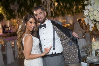 groom-wearing-custom-tuxedo-jacket-with-his-face-on-the-inside-lining-suspenders-and-bow-tie