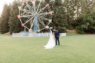 calamigos-ranch-wedding-bride-and-groom-pose-in-front-of-ferris-wheel