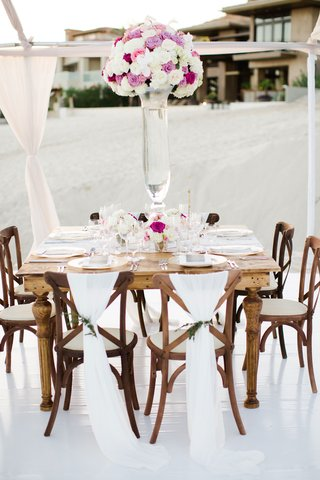 square-wood-table-wood-chairs-tall-white-purple-pink-flower-arrangement-barbie-blank
