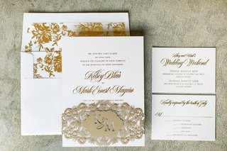 white-invitation-suite-with-gold-writing-gold-floral-print-envelope-liner-champagne-laser-cut-band