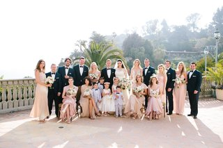 groomsmen-in-mr-tuxedo-bridesmaids-in-bhldn-ghost-joanna-august-reformation