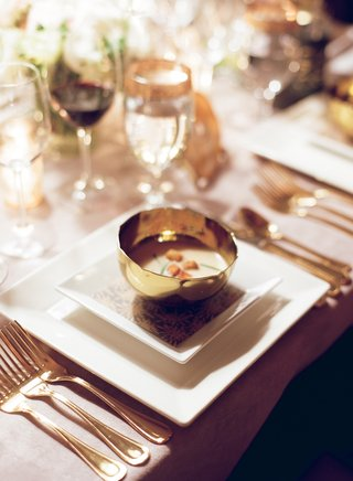 wedding-soup-in-gold-bowl-with-crouton-garnish