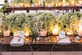 ghost-chairs-around-wood-table-with-candles
