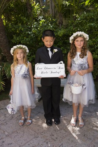 flower-girls-in-silver-with-suited-ring-bearer-with-funny-sign