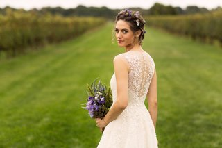 vineyard-lyndsy-fonseca-actor-in-wedding-dress-embellishments-on-back-purple-flowers-with-florals