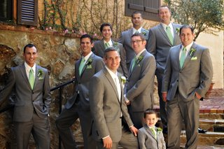 men-in-gray-tuxedos-with-green-ties-and-boutonnieres