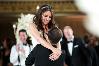wedding-reception-first-dance-photo-of-groom-picking-up-bride-during-dance-silver-headband