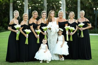 bride-in-monique-lhuillier-white-lace-wedding-dress-flower-girls-bridesmaids-black-gown-off-shoulder